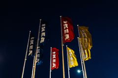RIGA, LATVIA - APRIL 3, 2019: IKEA flags during dark evening and wind - Blue sky in the background stock photos