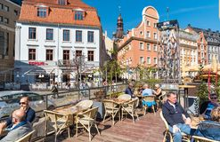 People relaxing and enjoying outdoor bar in the historic center of Riga, Latvia Stock Photo