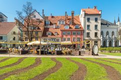 People relaxing and enjoying outdoor bar in the historic center of Riga, Latvia Royalty Free Stock Photos