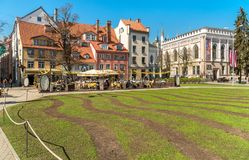 People relaxing and enjoying outdoor bar in the historic center of Riga, Latvia Royalty Free Stock Photo