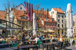 People relaxing and enjoying outdoor bar in the historic center of Riga, Latvia Stock Images
