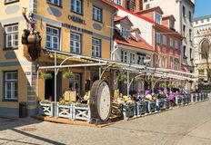 People relaxing and enjoying outdoor bar in the historic center of Riga, Latvia Stock Image