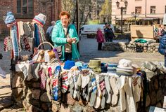 Woman Seller of knitted gifts made for tourists in the historic center of Riga, Latvia Stock Photography