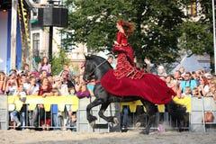 Free RIGA, LATVIA - AUGUST 21: Camilla Naprous From The Devils Horsemen Stunt Team Riding Beautiful Black Horse During Riga Festival O Stock Image - 36317131