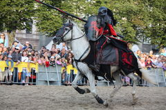 Free RIGA, LATVIA - AUGUST 21: Gerard Naprous From The Devils Horsemen Stunt Team Riding White Horse During Riga Festival On August Stock Photography - 36317292