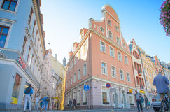 Riga, Latvia - August 10, 2014 - famous narrow medieval architecture building street with church towers in old town Riga, Latvia. Riga is the European capital stock images