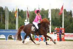 RIGA, LATVIA - AUGUST 12: Latvian rider Ingrīda Lizbovska show Stock Photos