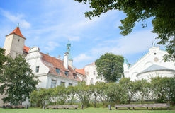 Riga, Latvia - August 10, 2014 - The picturesque view of the Riga Castle(the residence of President of Latvia) with Virgin of. Anguish Church in old town Riga stock photos