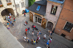 Riga, Latvia, 25-August-2015: view from above of old street. Riga, Latvia, 25-August-2015: view from above of old medieval streets, Swedish gate and tourists Stock Photography