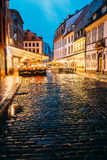 Riga, Latvia. Cafe In Lighting At Evening Or Night Illumination Royalty Free Stock Photos