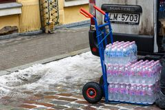 Delivery cart, full with plastic bottles stock image