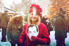 RIGA, LATVIA - January 4: girl with a photo of the actor of book Royalty Free Stock Images
