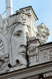 Bas reliefs on facade in Riga, Latvia. RIGA, LATVIA - JULY 11, 2017: Bas reliefs on facade of buildings in Art Nouveau style, located in historical `Quiet Center Royalty Free Stock Image