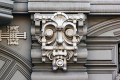 Bas reliefs on facade in Riga, Latvia. RIGA, LATVIA - JULY 11, 2017: Bas reliefs on facade of buildings in Art Nouveau  style, located in historical `Quiet Stock Photography