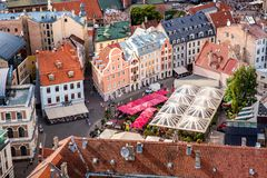 Central old town squre with toursits in Riga city, Latvia royalty free stock image