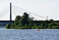 Riga, Latvia, 15 July, 2015. Couple kayaking in river Daugava near Riga, renting the canoe from Rigas laivas. Couple kayaking in river Daugava near Riga Stock Photos