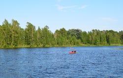 Riga, Latvia, 15 July, 2015. Couple kayaking in river Daugava near Riga, renting the canoe from Rigas laivas. Couple kayaking in river Daugava near Riga Royalty Free Stock Photos