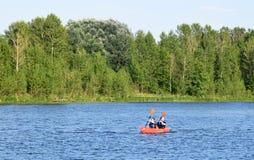 Riga, Latvia, 15 July, 2015. Couple kayaking in river Daugava near Riga, renting the canoe from Rigas laivas. Couple kayaking in river Daugava near Riga Royalty Free Stock Images