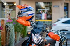 RIGA, LATVIA - JULY 31, 2018: Enduro motorcycle stands on the street side at the outdoor cafe. RIGA, LATVIA - JULY 31, 2018: Enduro motorcycle stands on the royalty free stock photo