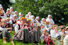 RIGA, LATVIA - JULY 06: People in national costumes at the Latvi. An National Song and Dance Festival on July 06, 2013. Holiday was hold from 30th June 2013 to Royalty Free Stock Images