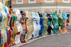 RIGA, LATVIA - JULY 26, 2018: United Buddy Bears exhibition. A m. An with a camera photographs the performance of the exhibition stock photo