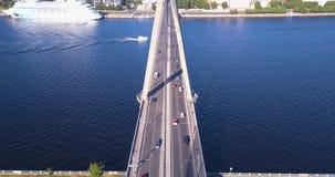 Aerial view of the suspension bridge over river Daugava in Riga. Riga, Latvia. June 02, 2018. Aerial view of the suspension bridge over river Daugava in Riga stock video footage