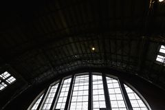 RIGA, LATVIA - MARCH 16, 2019: Riga Central market pavilion ceiling, people buying food - Former zeppelin hangars - stock photography