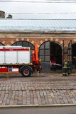 RIGA, LATVIA - MARCH 16, 2019: Fire truck is being cleaned - Driver washes firefighter truck at a depo - Van in a garage royalty free stock image