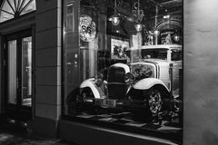 Riga, Latvia - March 20, 2017:  white Hot Rod in Rout 66 american vintage bar at night, black and white. Riga, Latvia - March 20, 2017:  white Hot Rod in Rout 66 Royalty Free Stock Photography