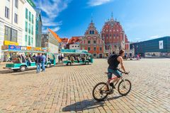 RIGA, LATVIA - MAY 06, 2017: View On Riga Town Hall Square And Small Tourist Bus That Are Located In The City Center Of Riga. Royalty Free Stock Photos