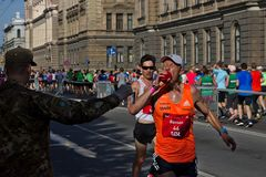 Riga, Latvia - May 19 2019: Elite male Runner Roman showing water to hes mouth stock images