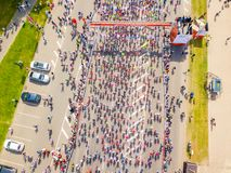 Start on the embankment and people running by the Daugava river and statue of liberty Milda. stock photo
