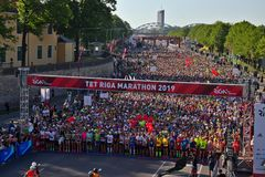 Riga, Latvia - May 19 2019: Participants of Riga TET marathon queuing at the start line stock photos