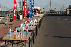 Riga, Latvia - May 19 2019: Refreshments prepared for marathon runners next to empty road royalty free stock photo