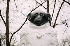 Riga, Latvia. Monkey statue in a spacesuit in Kronvalda park. St Royalty Free Stock Images