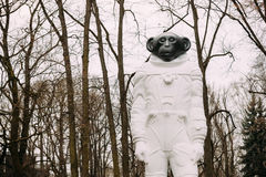 Riga, Latvia. Monkey statue in a spacesuit in Kronvalda park. St Royalty Free Stock Photo