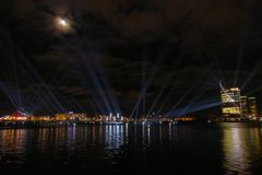 Panoramic view over the river Daugava to the multi-colored light show exhibition stock images
