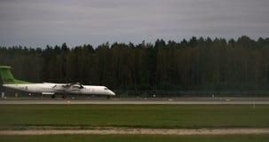 RIGA LATVIA - OCTOBER 8: Airbaltic plane workflow in airport in Riga, October 8, 2016 in Riga stock video