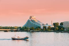 Riga, Latvia. Pleasure Boat Floating On Daugava River With View. Of National Library On Background royalty free stock image