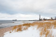 Riga port lighthouse at the coastline in winter. Riga, Latvia: Riga port lighthouse at the coastline in winter Royalty Free Stock Photos