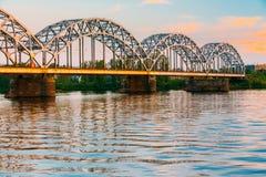 Riga, Latvia. Railway Bridge Through Daugava Or Western Dvina River. At Sunny Evening Sunset stock photos