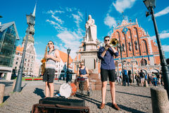 Riga Latvia Street Music Trio Band, Three Young Guys Playing Instruments For Donation Stock Images