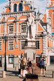 Riga Latvia Street Music Trio Band, Three Young Guys Playing Instruments For Donation On The Town Hall Square. Riga, Latvia - July 1, 2016: Street Music Trio stock image