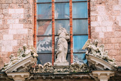 Riga Latvia. Three Ancient Baroque Statues On Top Of Portal Of Main Entrance To St. Peter Church, Stock Photography