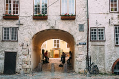Riga Latvia. Three Young People With Guitar In Arch Of Swedish Gate Royalty Free Stock Photo