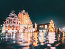 Riga, Latvia. Town Hall Square, Popular Place With Famous Landmarks On It In Night Illumination In Winter Twilight. Riga, Latvia. Panorama Of Town Hall Square royalty free stock photo