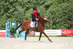 RIGA, LETLAND - AUGUSTUS 12: Letse ridi van sportmanguntars Silinsh Royalty-vrije Stock Foto's