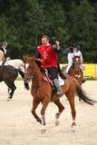 RIGA LETTLAND - AUGUSTI 12: Lettisk idrottsmanGuntars Silinsh ridi Arkivfoto