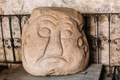 Riga, Lettonie La tête de pierre de Salaspils est la statue en pierre de l'idole slave antique images libres de droits