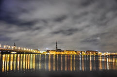 Riga at night. Reflecting in the water Stock Photo